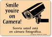 Bilingual Smile You're On Camera Sign With Graphic