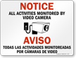 Bilingual Activities Monitored By Video Camera Sign
