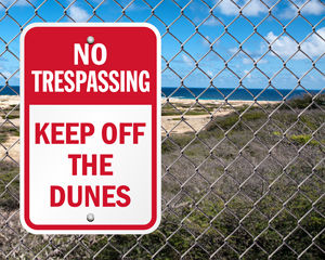 No trespassing keep off dunes sign