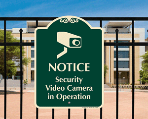 Security Cameras in Operation Signs