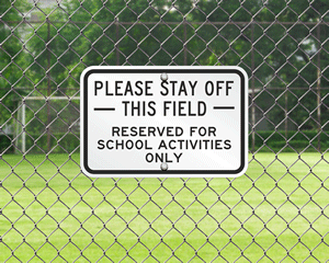 Stay off of school field sign
