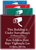 Bilingual Building Under Surveillance Sign