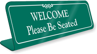 Please Be Seated Showcase Desk Sign