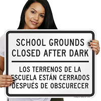 Bilingual School Grounds Closed After Dark Sign