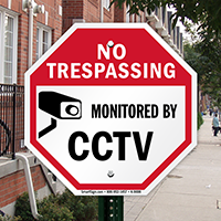 No trespassing monitored by CCTV with graphic Signs
