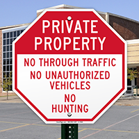 No Unauthorized Vehicles & No Hunting Sign