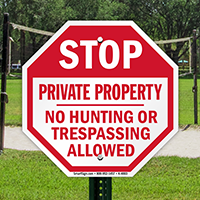 STOP: Private Property No Hunting or trespassing sign