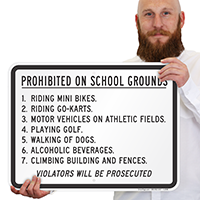 Prohibited on School Grounds Violators Prosecuted Sign