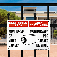 Bilingual Restricted Area Monitored By Video Camera Sign