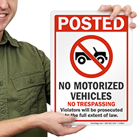 No Motorized Vehicles No Trespassing Signs