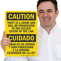 Caution Theft Prosecuted Bilingual Sign