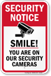Smile You're On Our Security Cameras CCTV Sign