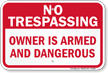 Owner Is Armed No Trespassing Sign