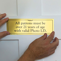 Patrons over 21 valid photo ID sign with protective premask