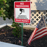 Property under video surveillance signs