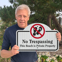 No trespassing sign for private beach property