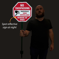 Reflective video surveillance sign for lawn