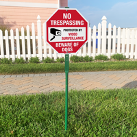 No trespassing beware of dogs video surveillance sign for lawn