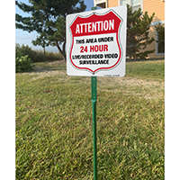 Under video surveillance sign for lawn