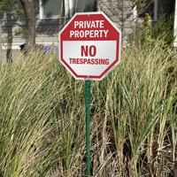 Reflective no trespassing sign