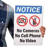 No Cameras No Cell Phone No Video Signs