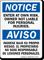 Enter At Own Risk Bilingual Sign